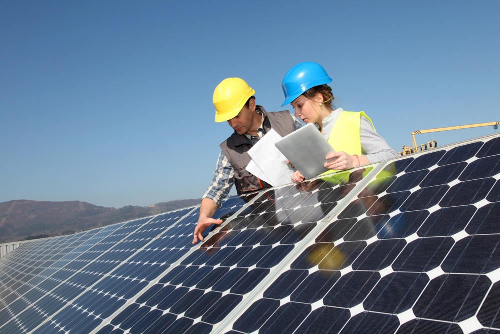 Man showing solar panels technology to student girl.jpeg